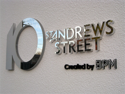 Lasercut polished stainless steel with acrylic backing