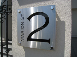 Stencil Cut Stainless Steel House Sign